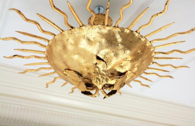 Brutalist Hand-Hammered Gold Gilt Iron Sunburst Light Fixture with Flower Detail For Sale 1
