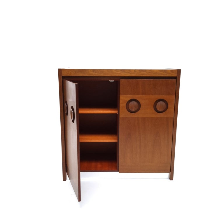 Brutalist mahogany sideboard or credenza by De Coene Frères. Two doors fastened by magnets open to reveal three storage cubicles.