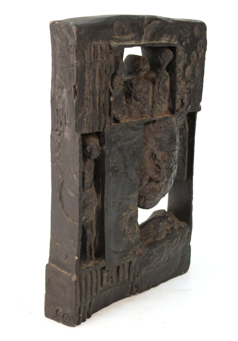 Brutalist modern movement figurative sculpture in plaster, can be displayed or mounted on a wall. The piece dates to the 1960s and is in good vintage condition, with signature and date as well as other marks on one of the sides.