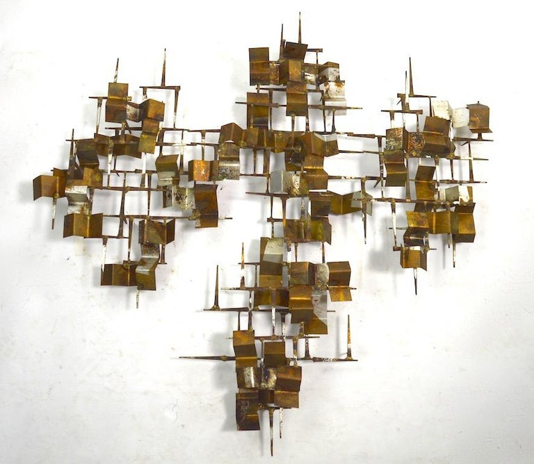 Great period Brutalist nail sculpture with mixed metal (Copper, Steel, Brass) flat folded elements. Interesting twist on the more common more often seen Starburst form. This example is unsigned.