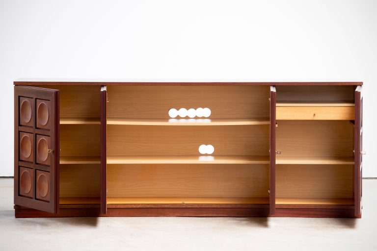 Brutalist sideboard from the 1970s by Gerhard Bartels, in the style of 'De Coene'. This sideboard has 4 doors with a graphic pattern. This sideboard offers a lot of storage space with shelves and drawers. The accompanying keys are available. The