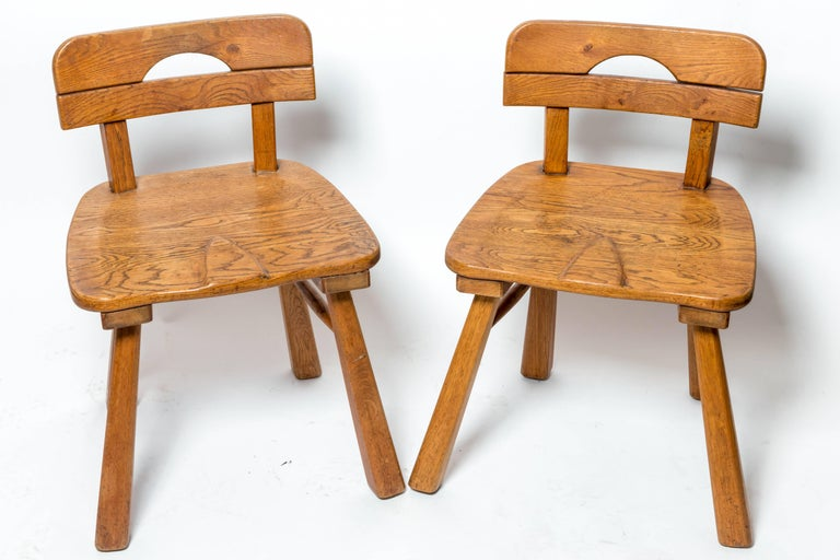 Brutalist oak stool or side chair with back by Cercle Jean Touret for Marolles, France, 1950s.