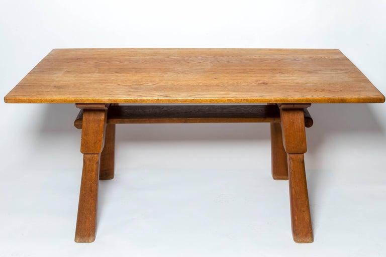 Brutalist oak table by Cercle Jean Touret for Marolles, France, c. 1950s.