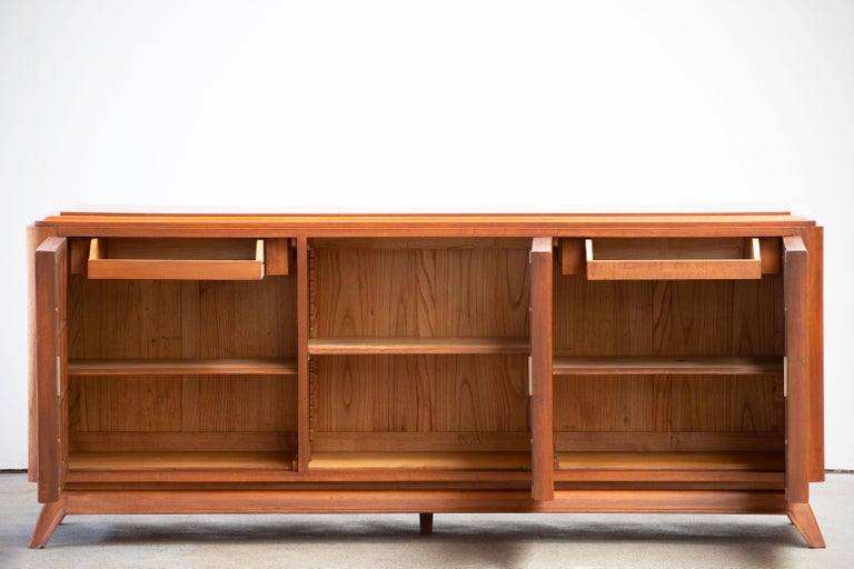 Credenza, solid oak, France, 1940s. Large Art Deco Brutalist sideboard. This heavy Brutalist credenza seems to float on its elegant base. The credenza consists of three large storage facilities and covered with very detailed designed door panels.