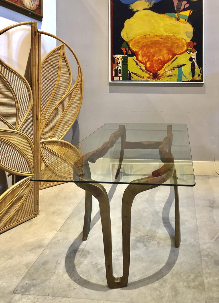 Brutalist studio sculptural bronze and wood desk or table  Offered for sale is a stunning studio crafted bronze and wood sculptural desk. An original creation, this Brutalist table supports a rectangular glass top. A wonderful addition for the