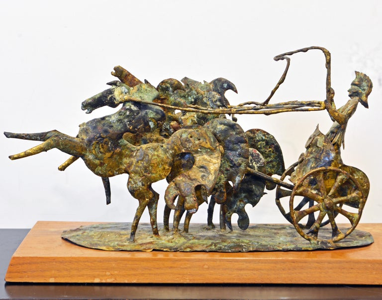 In this expressive bronze sculpture Bill Lett is capturing the ferocity and vigor of a Roman charioteer and his horses. The bronze has been patinated to a rich mottled surface and is resting on a wood base bearing a small artist plaque.  Bill