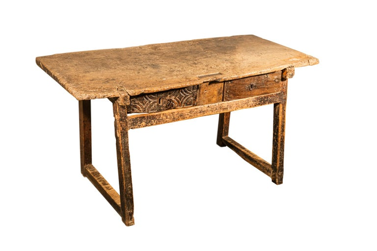 Brutalist table with two drawers, accidents and losses, patina and wear consistent with artisanal use, vintage condition, Spain, late 18th century.  Measures: Width 138 cm, height 70.5 cm, depth 62 cm.