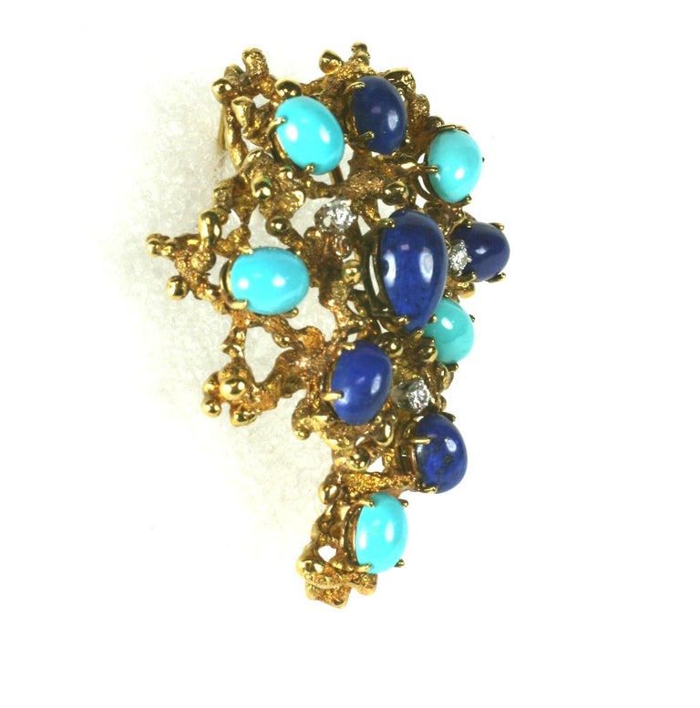 Brutalist Turquoise, Lapis and Diamond Brooch in heavy 18k gold setting. Oval and pear shaped stones are mounted above the dimensional setting with diamond accents. Interesting, high quality setting. Stones to appear to be sitting on raised bed of