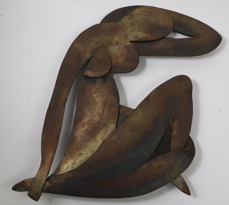Impressive iron sculpture in the Brutalist style, after Matisse. This wall hanging was made in the 1960s by a Woodstock NY artist ( name unknown ) it is in very good original condition, well executed and heavy. Hangs from a wire connected to two