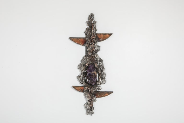 Art sculpture by Marc D'haenens, the 1970s.  The piece shows a variety of organic shapes in metal and copper, and a large piece of Amethyst as centerpiece.