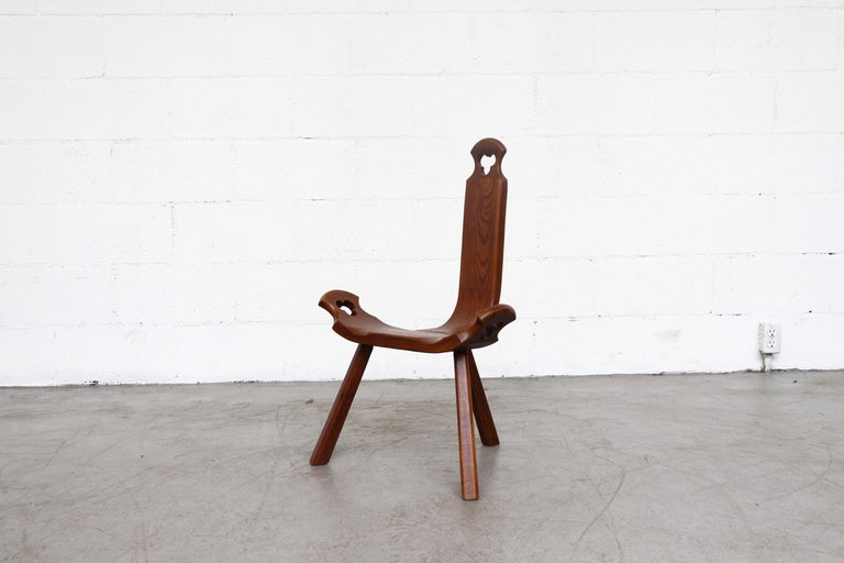 Mini Brutalist wood tripod chair with cut-out detail. Deceivingly comfortable three-legged and three-paneled seat create an amazing Silhouette. In original condition with some signs of visual wear consistent with age and use.