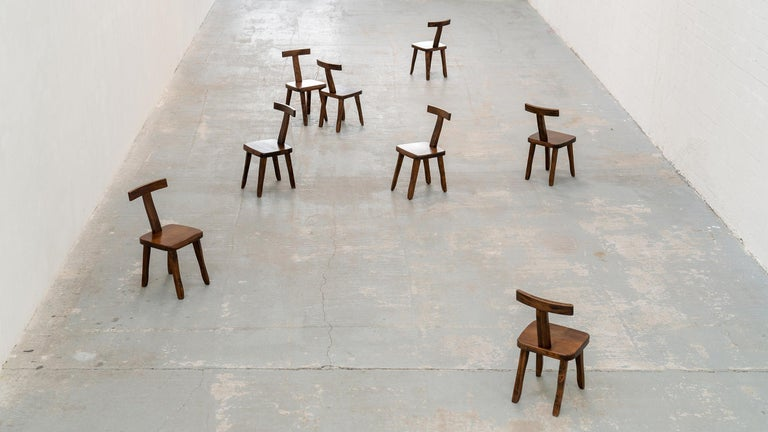 Brutalistic & Minimalistic - Olavi Hänninen - T chairs in solid elm - 1958 for Mikko Nupponen, Finland  Set of 8 (we can provide 10 chairs if needed)  These solid chairs are made of stained elm wood and sculpturally crafted by hand.  Rustic,