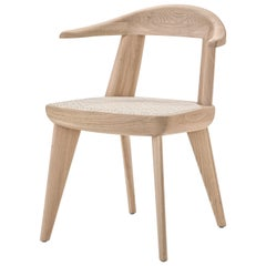 Brutus Armchair in Solid Wood with Cane Seat Designed by Craig Bassam