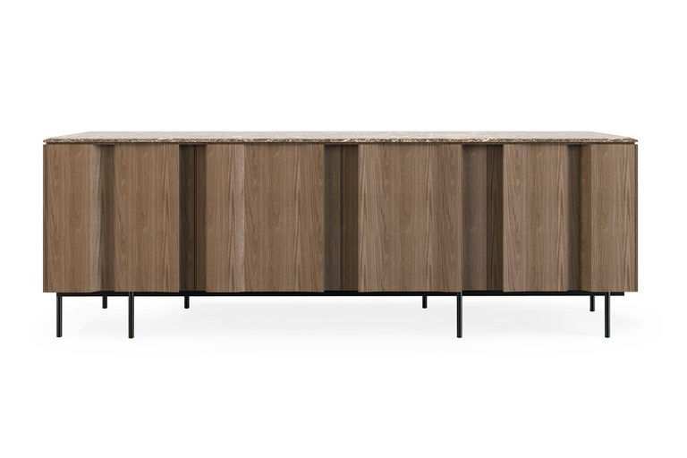 Bryant sideboard by Collector Materials: Marble top. Wooden doors and structure. Legs in metal with a painted finish. Lacquered interior. Dimensions: W 202 x D 50 x H 72 cm   A series of vertical lines runs from top to bottom shaping the