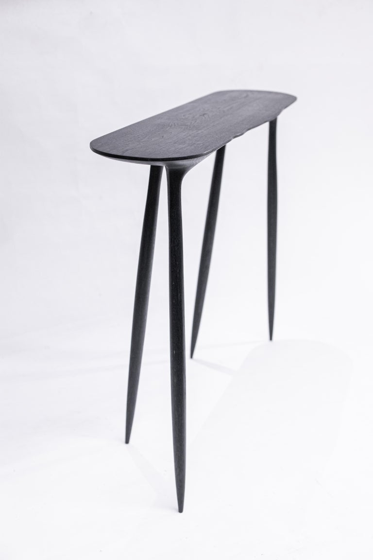 BTRFL oak console by Cedric Breisacher Dimensions: L 110 x L 35 x H 80 cm Materials: Oak, Oxyde black  Different finishes or dimensions could be made to order.  Designer-sculptor, Cedric Breisacher has an atypical path. Self-taught man, he