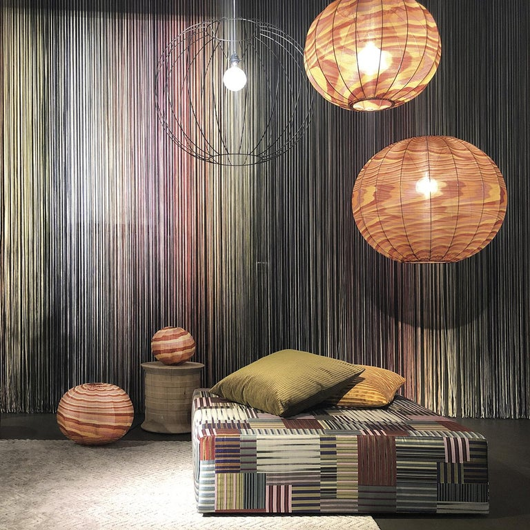A light metal frame and fabric cover, but so much more. This lantern takes the form of a bubble floating in mid-air, brilliantly blending a light and airy design with a cheerful pattern in full Missoni style. Available in four sizes in both pendant