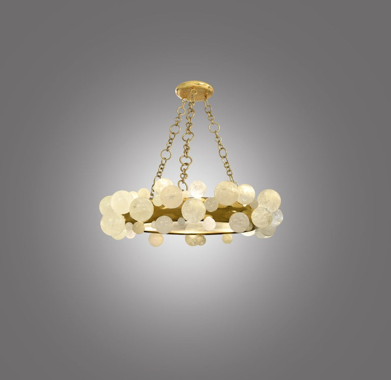 Rock crystal bubble chandelier with polish brass frame. Created by Phoenix Gallery, NYC. 6 sockets installed. Supplies 60w each led warm light bulbs. Custom size and metal finish upon request.