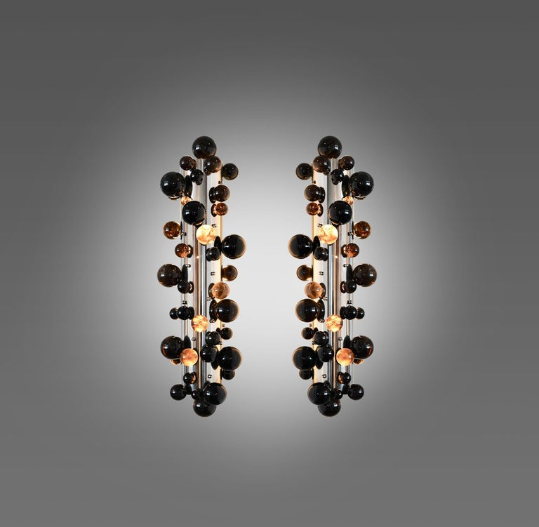 Pair of dark bubble rock crystal sconces with the nickel plating finish. Created by Phoenix gallery NYC. Each sconce installed two sockets. Use two 80w LED warm light bulbs. Total 160w max. Light bulbs included.  Custom size upon request. Recommend