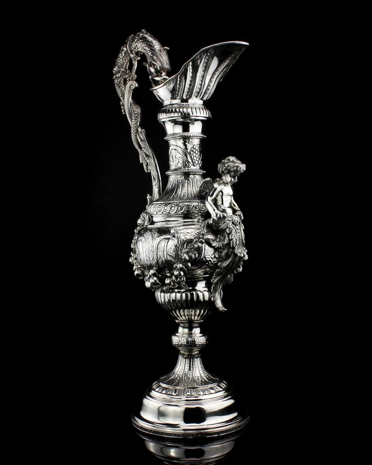 Buccelatti antique silver wine ewer. Elaborately engraved in high relief and realistic figures. Designer: Buccelatti Made in Italy circa 1900 Hallmarked Buccelatti  Dimensions -  Height 59cm Length 26.5 cm Weight 4035gr  Condition: