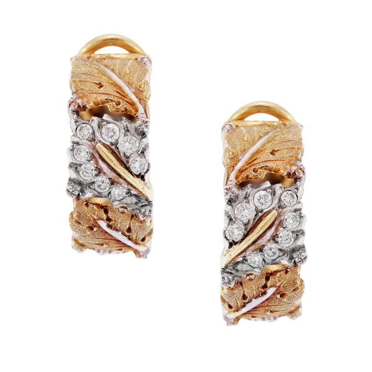Buccellati 18K Yellow White Gold Diamond Floral Hoop Earrings  This stunning pair of earrings by world renowned designer, Buccellati feature incredible workmanship and beautifully done floral design  0.32 carat G color, VS clarity white
