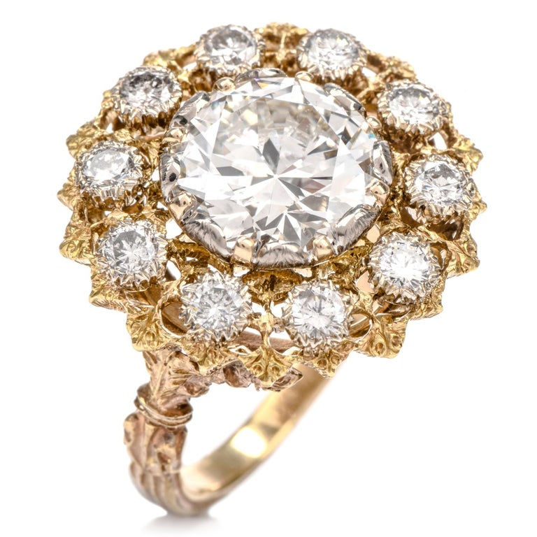This exquisite vintage diamond Buccellati engagement cocktail ring was inspired by a   natural flower motif and crafted in 18K yellow gold.  Prominently showcased in the center of this ring is one European cut diamond  weighing appx. 3.40 carats and