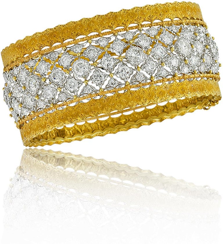 18K Gold and Diamond Buccellati Bangle Bracelet set with 116 Diamonds approximately 12.50ct; Made in Italy; Ca1960. Founded by Mario Buccellati in 1919, Buccellati has stood as one of the premier jewelry makers for 100 years. The family-run house
