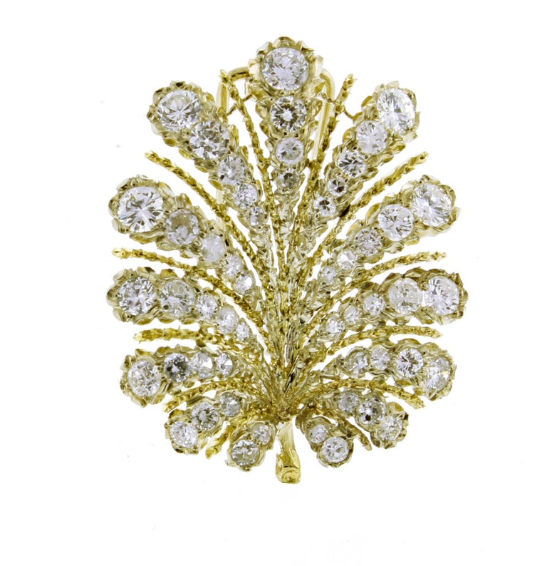 From Italian jewelry master Buccellati, this nature inspired, mid-20th-century diamond leaf brooch. ♦ Designer: Buccellati ♦ Metal: 18 karat ♦ 25 diamonds = 2.45 carats ♦ Circa Mid century ♦  Size 1 3/8 X 1  1/8 ♦ Packaging: Pampillonia