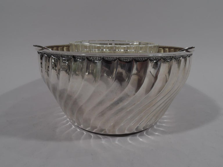 Italian Classical sterling caviar bowl. Curved and tapering sides with swishing, twisting flutes and discreet stippled lunettes near flat rim. Detachable tripod open frame with fluted clear glass bowl. A beautiful addition to the buffet. Fully