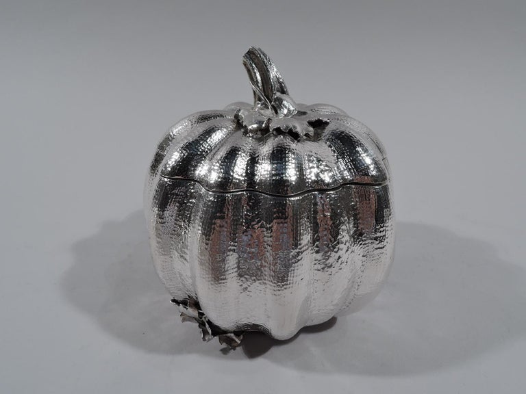 "Figural sterling silver box. Gourd-form with lobes and stippled skin. Cover has leafing-stem finial. Rests on 3 leaf supports. Nubby and irregular. Marked ""Buccellati / Italy / Sterling"" and post-1967 Italian mark for Pradella Ilario. Weight: 13.5"