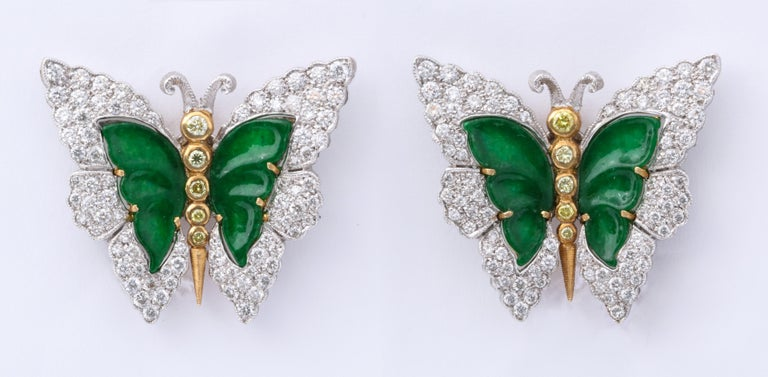 Extremely rare butterfly earrings by Buccellati featuring a yellow diamond set body, further embellished with carved green jade and diamond set wings.  Delicate and feminine on the ear, they epitomize the creativity of one of Italy's finest