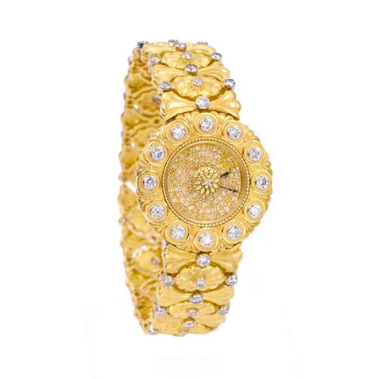 Buccellati Gold and Diamond Watch. This watch has diamonds with a total carat weight of XXct set in 18k yellow gold with a floral design.  Signed: Gianmaria Buccellati, Eliochron Jeweled, Italy Buccellati Watch Box.