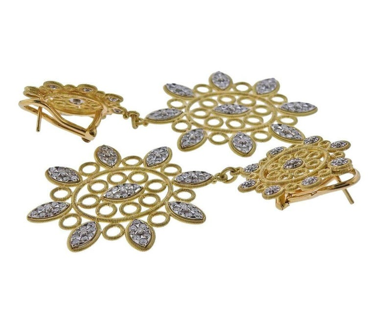 Pair of 18k gold openwork Carlotta drop earrings by Buccellati, with approx. 2.90ctw in H/VS-Si diamonds. Earrings measure 67mm x 35mm. Marked - Buccellati, Italy, 18k. Weight - 22.8 grams. Current Retail Price $19900