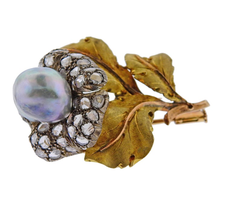 18k gold and silver brooch by Buccellati, set with rose cut diamonds and an approx. 12.5mm x 10.8mm pearl.  Brooch is 44mm x 32mm and weighs 13 grams. Marked Buccellati.