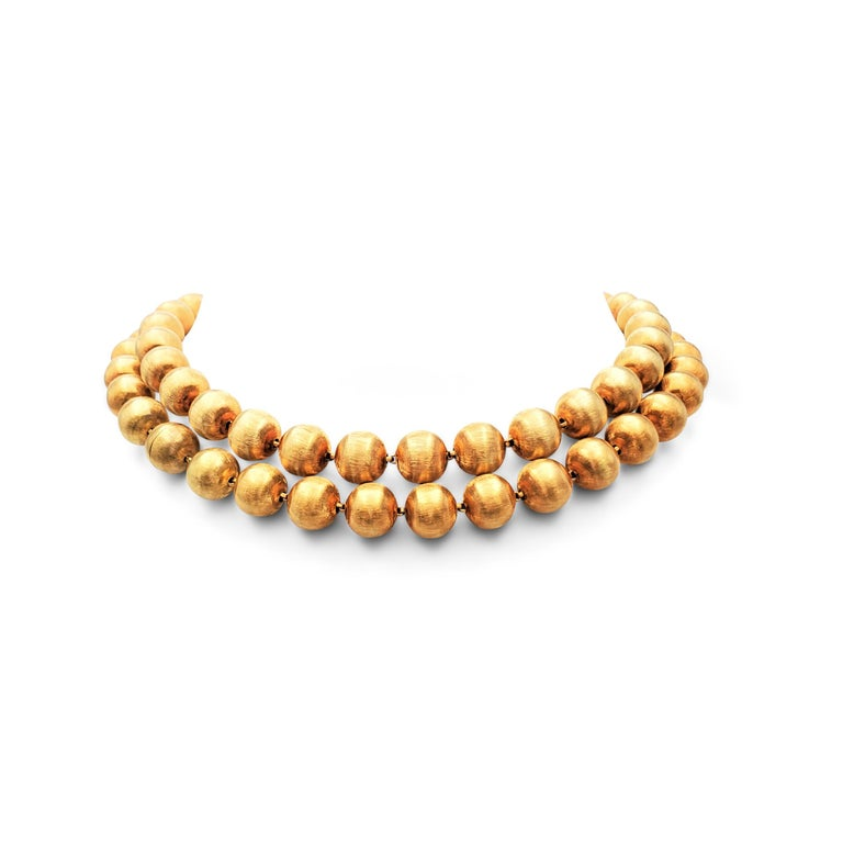 Authentic Buccellati 'Rigato' suite comprised of a necklace, composed of 18 karat yellow gold beads in a lustrous florentine finish, a pair of earrings, and a convertible necklace/bracelet set. Signed M. Buccellati, Italy, 750. Not presented with
