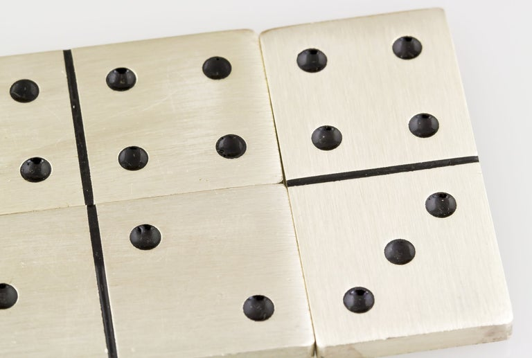 Fine collectible set of sterling silver dominoes by Buccellati. They feature all 28 pieces and comes with original case.  Hallmarks: Buccellati, Sterling, Italy.