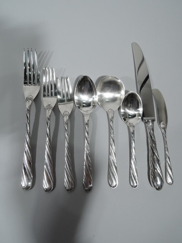 Torchon sterling silver dinner set for 12. Made by Buccellati in Italy. This set comprises 96 pieces (dimensions in inches): Forks: 12 dinner forks (8 1/2), 12 dessert forks (7 1/2), and 12 salad forks (7), spoons: 12 dessert/soup spoons (6 7/8), 12