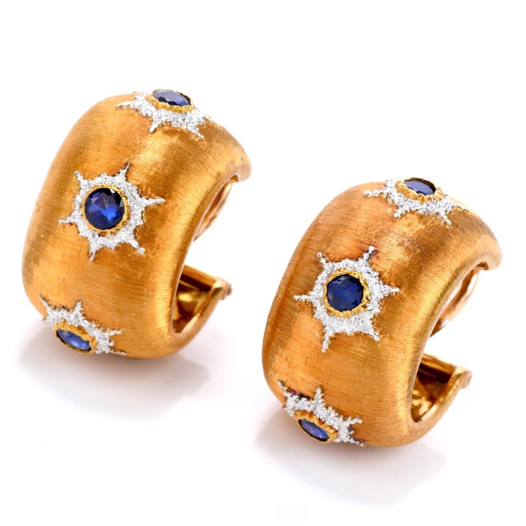 Finish your Look with these Vintage Buccellati Sapphire Earrings.  These Vintage Buccellati Rigato Finish wide band Hoops are crafted in Luxurious 18K yellow and white Gold. Adorning the patterns are 6 round faceted Sapphires for a combined weight
