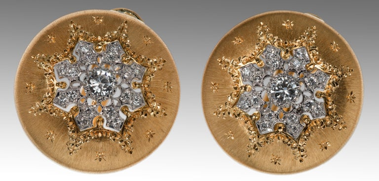 These generously proportioned earrings are among the best examples of craftsmanship, materials and style from this master Italian jeweler. Famous Buccellatti etching on the 18k yellow gold is further enhanced by 34 round bezel set diamonds totaling