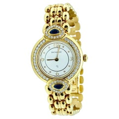 Bucherer Paradiso 18 Karat Yellow Gold, Diamond and Sapphire Ladies Watch