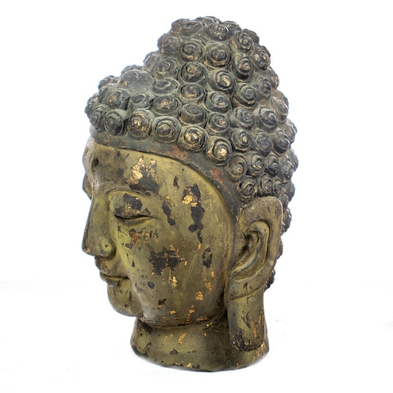 Carved wood Buddha handmade head. Antique Asian sculpture full of tradition and mysticism created with extreme detail evoking ancient times. Made by fantastic local artists which transform natural materials into unique art works. This sculpture is