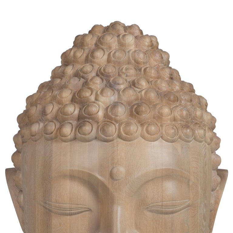 Sculpture Buddha head  hand carved in solid raw oak.