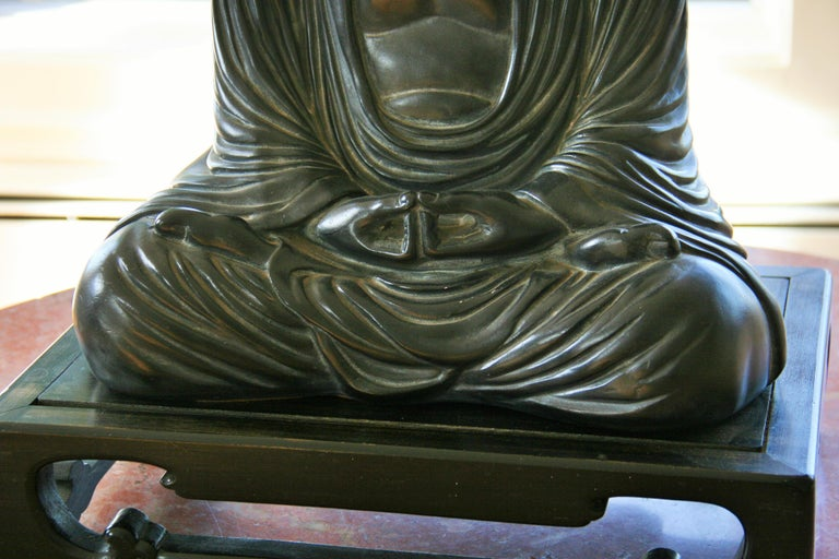 Buddha Sculpture on Wood Base In Good Condition For Sale In Douglas Manor, NY