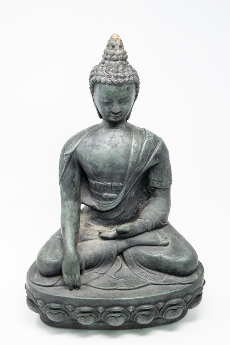 Sandstone garden statue of seated Buddha. Contemporary design makes the piece a standout in the garden or entryway.