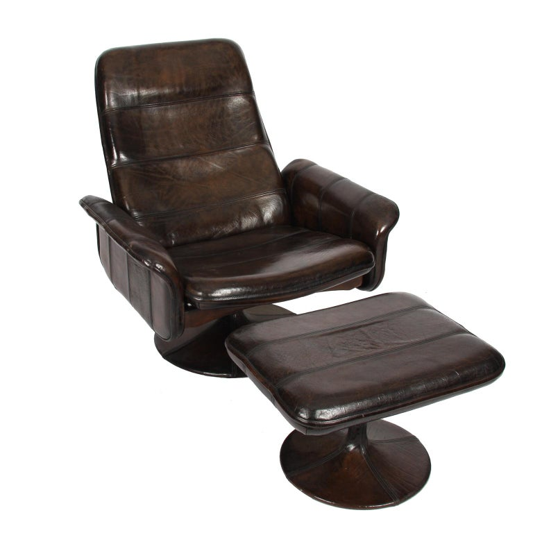 Switzerland, 1970s  A chic and comfortable, buffalo leather, reclining lounge chair and ottomon by De Sede.