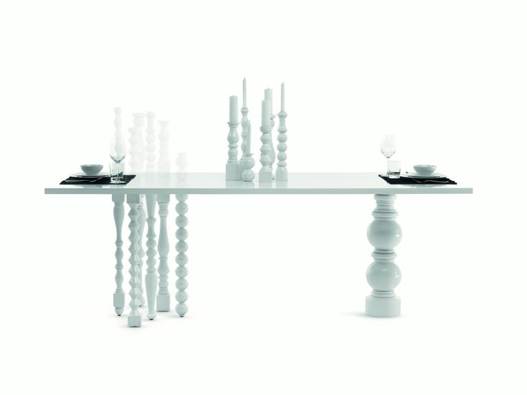 Lies the table was designed by Annabeth Philips designers for the brand Mogg. Ashwood table with legs and seven candlesticks in turned solid. Available glossy white RAL 9016 direct.  Very special design for this table, minimal and dynamic. The