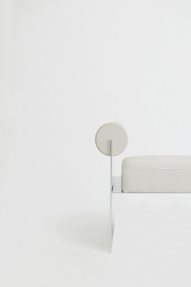 Building blocks side lounge chair: An illusion that plays with positive and negative shapes through its design, the white version is made from leather and a metal base.