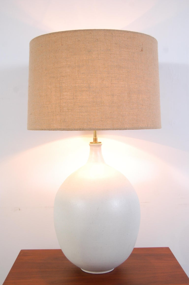 Design Technics pottery lamp, by Lee Rosen, circa 1966. Lamp body has a wonderful, bulbous form, with a magnesium white glaze. Lamp has been completely re-wired for safety, as all vintage lighting should be, and top quality, solid brass hardware has