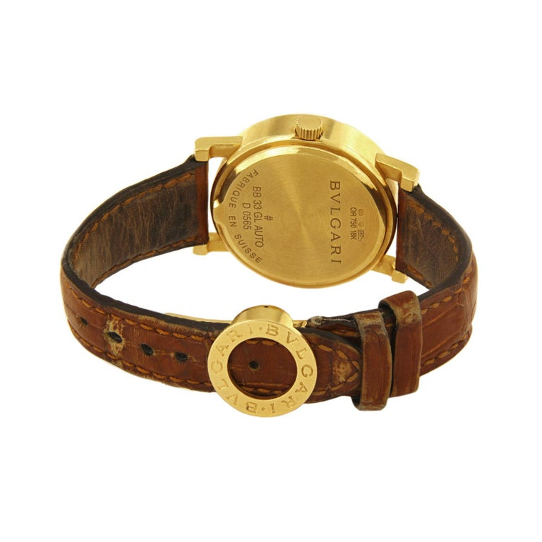 BULGARI 18K YELLOW GOLD AUTOMATIC WATCH BB33GL  -Mint condition case. Strap shows signs of wear. Sold as is. -18k Yellow Gold -Movement: Automatic -Case size: 33mm -Case thickness: 8.3mm -Date indicator -Sapphire Glass -Folding clasp  *Comes with