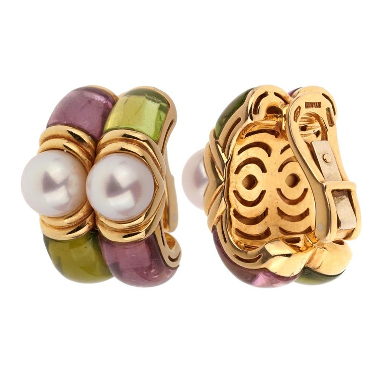 A chic pair of Bulgari earrings featuring carved Amethyst, Peridot, and Pearls in 18k yellow gold. The earrings measure 1/2