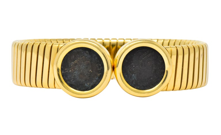 Flexible tubogas style bangle  With bezel set ancient coin terminals  Coins depict the profile of Emperor Constans of Rome  Inscribed on coin bezel verso 'Roma Constans I AVG A.D. 337-350'  From the Monete collection   Fully signed Bulgari with